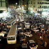 A traffic street scene at night in downtown Cairo
