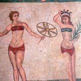 Mosaic in the Roman Villa of Casale, near Piazza Armerina, Sicily, Italy. The villa boasts the best collection of Roman mosaics in the world and is a UNESCO World Heritage Site. This example shows women exercising. Credit: Spectrum Colour Library / HIP / TopFoto