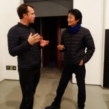Dailininkas Rodionas Petrovas ir kuratorius Xin Dong Chengas. Remigijaus Treigio nuotr.